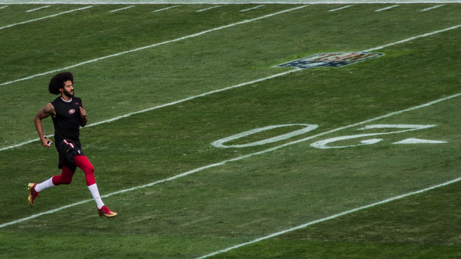 Colin Kaepernick warms up for his first preseason game of the 2016 season  Photo Courtesy of Flickr via Creative Commons
