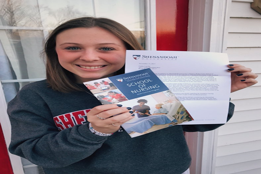 Carter Lawler poses with her acceptance letter to Shenandoah University