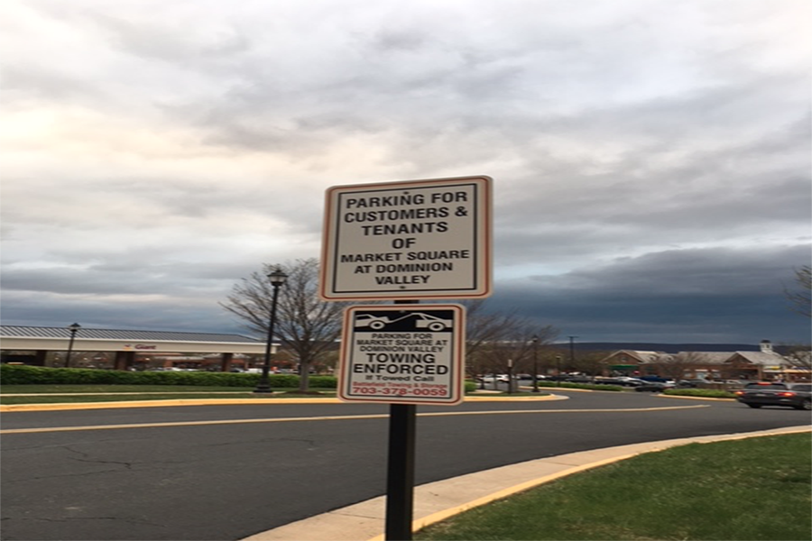 New sign threatening towing at entrance to Market Square at Dominion Valley (Photo courtesy of Maddi Koch)