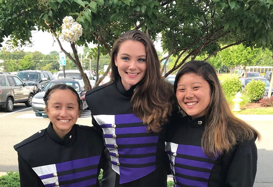 Senior Erica Clear (middle) stands with two of her friends in the Battlefield High School Marching Band.