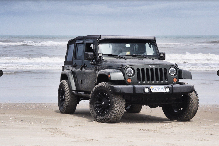 Senior Garrett McGee's 2007 army green Jeep Wrangler poses at Carova Beach in North Carolina.