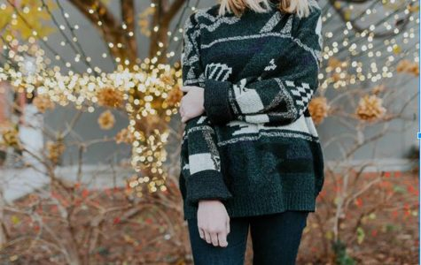 A girl wearing a Christmas sweater. Photo courtesy of Max Pixel via Creative Commons.