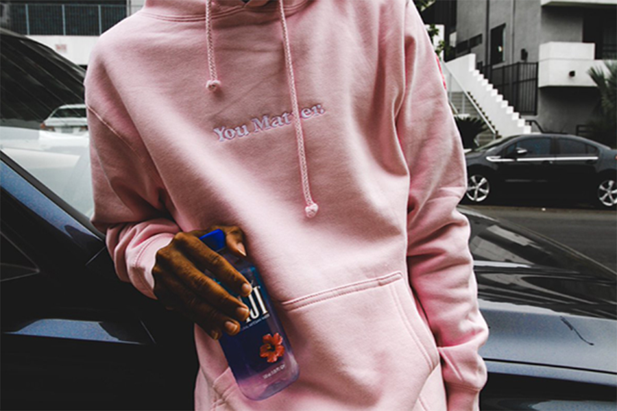 Demetirus Harmon modeling his limited edition pink hoodie for breast cancer awareness month