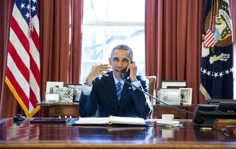 President Obama sits in the Oval Office