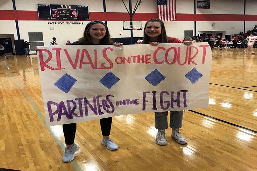 A poster being held up by two MiniTHON participants at the BHS vs PHS basketball game for our Miracle Minute. Photo courtesy of BHS MiniTHON Instagram.
