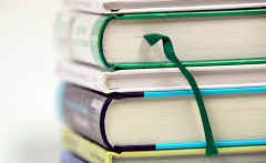 A stack of textbooks.  Photo Courtesy of PxHere via Creative Commons.