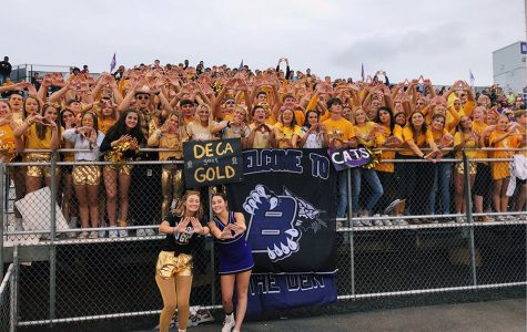 The Student Den at the Gold Out game, supporting the kids and the DECA cause.  Photo via Mrs. Murphy.