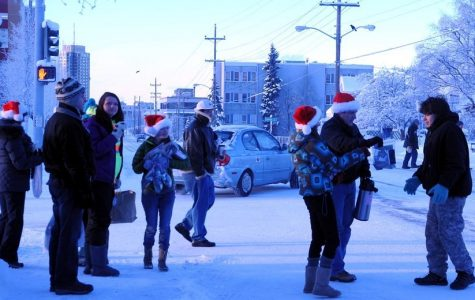 Community volunteers gather wearing Santa hats. Image courtesy of Flickr via Google Images.