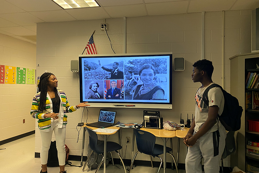 Two Black Student Union members presenting to the Buddy Club at their February meeting.  Photo Courtesy of Zoe Goehrig via Private Collection