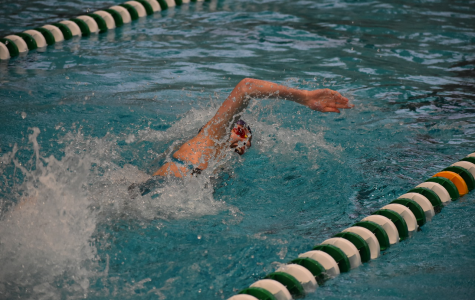 Freshman Camille Spink swimming her record-breaking 100 freestyle. Photo courtesy of Charlotte Peyton.