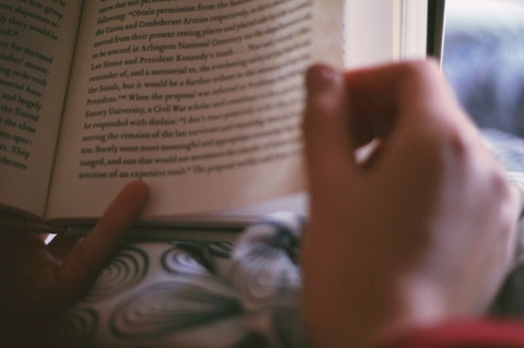 Someone reading a book, an activity many chose to take part in during quarantine  Photo credit via Creative Commons